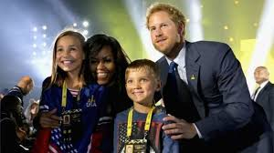 michelle obama and prince harry pose with children of servicemen and women competing in the invictus bbc sydney offices office