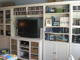 Living Room With Bookcase Uncluttering The Bookshelves Done