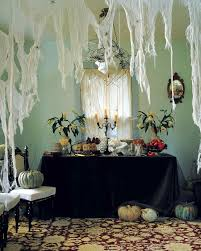 love halloween window decor:  cheesecloth webs sip vert
