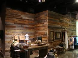 accent wall made from gray and brown barn boards for m marie boutique in winter park barn boards