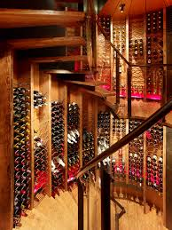 queens lane compound rustic wine cellar circular spiral glass staircase to the basement awesome awesome wine cellar