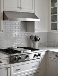 in style kitchen cabinets:  white kitchen subway tiles backsplash and matching cabinets