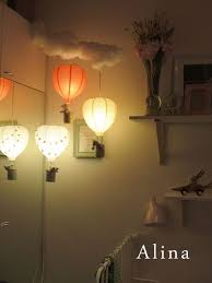 i love this idea of hot air balloon lights to add a little whimsy to a baby room lighting ceiling