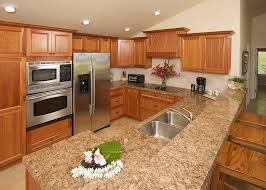 kitchen cabinets with granite countertops:  small corner kitchen design room with brown wooden cabinets granite countertops with single sink