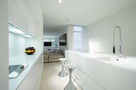 beautiful white kitchen cabinets: modern white kitchen design with eat in bar
