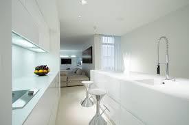 beautiful white kitchen cabinets: modern white kitchen design with eat in bar