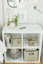 white decor styling i like the gold incorporated with white i would add maroon and black i
