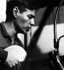 Antonio-Carlos-Jobim-aka-Tom-Jobim-playing-guitar-. Antônio Carlos Brasileiro de Almeida Jobim (January 25, 1927 in Rio de Janeiro – December 8, ... - Antonio-Carlos-Jobim-aka-Tom-Jobim-playing-guitar-photographer-unknown