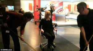 a crew member is seen shoving a female colleague on her chair along the studio floor bbc sydney offices office