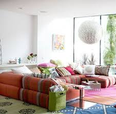 spacious sofa with lots of throw pillows in colorful patterns is the first thing you should bohemian living room furniture