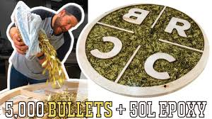 I Pour <b>5,000</b> Bullets & 50L Of EPOXY Into A Table! - YouTube