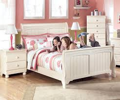cottage retreat full size sleigh bed by ashley furniture cream finish post bed for girls ashley furniture bedroom photo 2