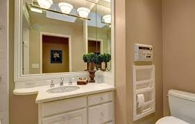 bathroom lighting fixtures over mirror with cream wall paint colors above mirror bathroom lighting