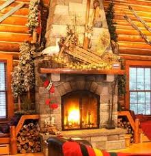 cabin decor lodge sled: mantel decorated with sled skiis snowshoes and lit greenery