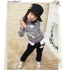 صور ازياء الاطفال الصغار images?q=tbn:ANd9GcT