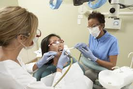 what does a dental assistant do carrington edu dental assistants working on teeth