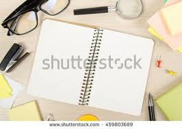 essays stock photos royalty free images amp vectors   shutterstock white blank open notepad book on office desk table background with office supplies education business