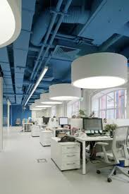 saturated blue surrounds bright whites in this media agencys office agency office literally disappears hours