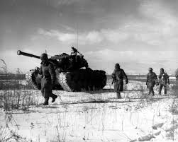 the korean war briefly describes the cause and effect of the a column of troops and armor of the 1st marine division move through communist chinese lines