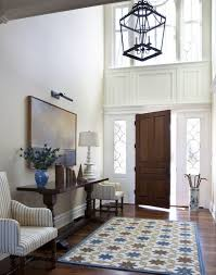 lighting brilliant chandelier for foyer entryway using metal frame pendant over patterned area rugs beside dark brilliant foyer chandelier ideas