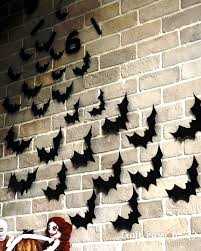 halloween gallery wall decor hallowen walljpg you may further decorate the bat swarmed wall by adding black tulle netting some spider webs and spiders on the corners of the wall or on the bar counter