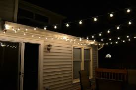 after we had the poles and screw eyes in we measured our string lights to make sure it would work out perfectly turns out it did backyard string lighting