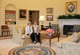 designers rena hardeman left and judy pesek sit on a sofa in the replica oval office photo courtesy of rena hardeman carpet oval office inspirational