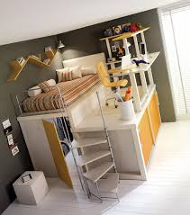 elevated bed with desk area closet and storage space below bunk bed office space