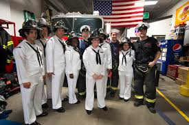 u s department of defense photo essay sailors assigned to the guided missile destroyer uss mcfaul pose for a photograph firefighters from