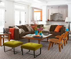 the overtly graphic lines of modern chairs and tables paired with deep shades of vibrant colors make a striking fun statement in this family room bhg living rooms yellow