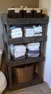 country themed reclaimed wood bathroom storage: open barn wood shelving  open barn wood shelving