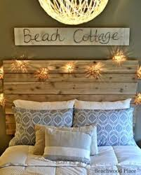 beach theme guest bedroom with diy wood headboard wall art and lots of annie sloan chalk paint beach theme furniture 1000