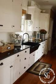 black appliance matte seamless kitchen: cream cabinets black granite or beige golden granite to blend with floor and the rest of the house since kitchen is visible from living room across the