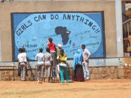 girls can do anything change your thoughts you change your world on a wall of one of the main buildings in adet s high school girls created