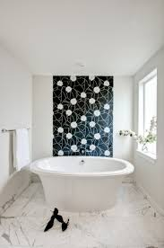 mosaic wall decor: nice  fascinating bathroom design with white color wall decor combined with black white broken mosaic tiles installation featuring rounded porcelain bathtub and white granite floor design florida tile forma