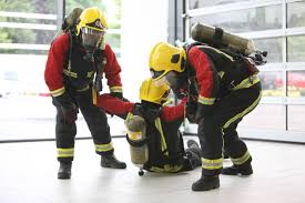 west midlands fire service firefighter taster sessions firefighters carrying a casualty