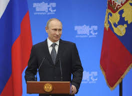 Image result for putin standing next to the russian flag