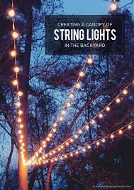 a gorgeous backyard setting is easy to achieve with a few string lights create your backyard string lighting