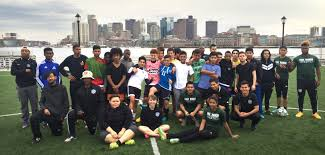 community service through the game of soccer pine manor college