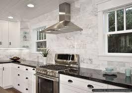countertops granite marble: black countertop white marble subway backsplash tile