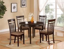 black kitchen dining sets: clean salmon ceramic floor tile with decorative brown rug pattern plus round black kitchen table set