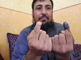 The Taliban cut off his finger for voting, he defied <b>them again</b> - Reuters