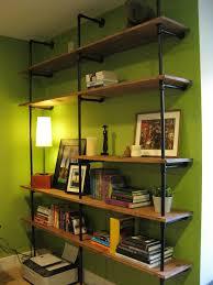 green black mesmerizing: diy open built in corner shelving diy black pipes built in corner bookshelves diy green wall easy making built in corner bookcases diy simple pipes built in