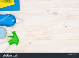 royalty cleaning items and tools lying on stock cleaning items and tools lying on textured white floor background frame for cleaning concept or advertising empty copy space around products stock photo