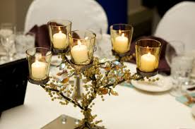 green black mesmerizing: interior glass candle holders with black branches like small tree with green ornaments placed