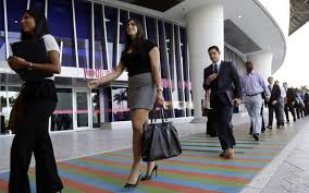 comparing new jobs numbers to economic reality here now job applicants arrive for an internship job fair held by the miami marlins at marlins park in miami oct 23 2013 lynne sladky ap