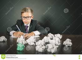 inspired school boy writing essay or exam stock photo image inspired school boy writing essay or exam