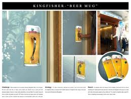 the outdoor advert titled door handle was done by j walter thompson mumbai advertising agency for product kingfisher lager brand united breweries in advertising agency office szukaj