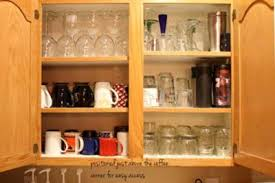 photos kitchen cabinet organization: easy to reach mugs amp glasses close to the sink and coffee station