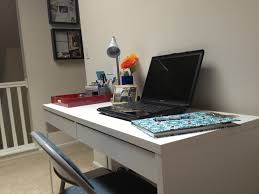 chic ikea micke desk in white with drawers and laptop before the white wall for home chic office desk hutch